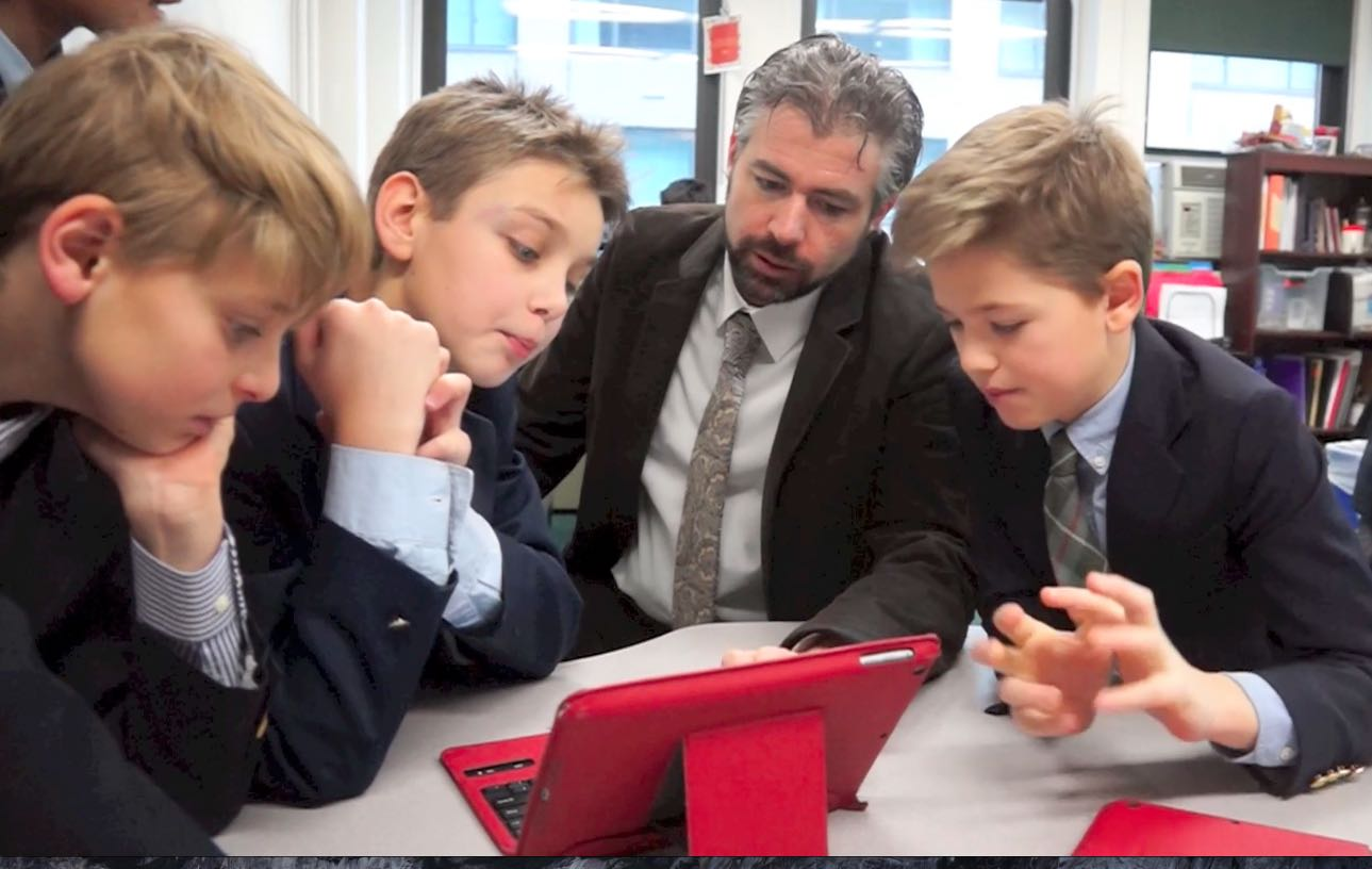 Room to Discover's Jeff, teaching a group of male students