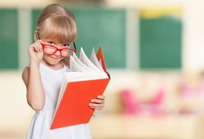 young female student reading a book