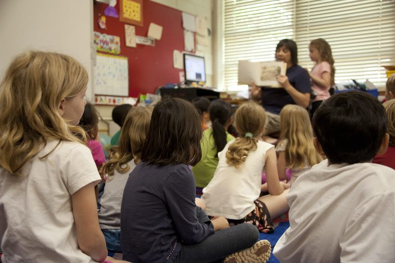Elementary School Teacher Reading to Her Class Being Observed According to the Danielson Rubric